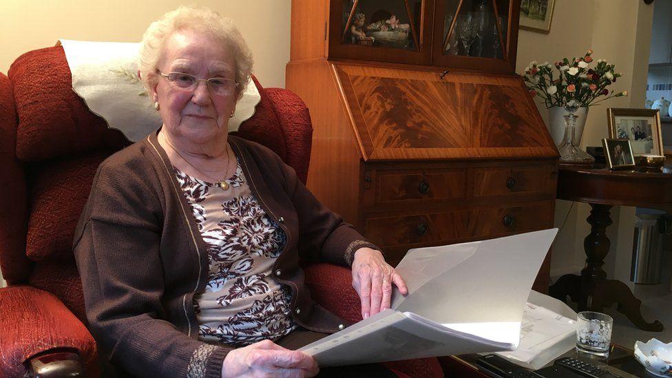Marjorie Smith sitting in an armchair