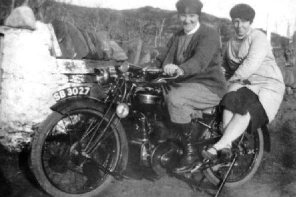 Two nurses on a motorbike
