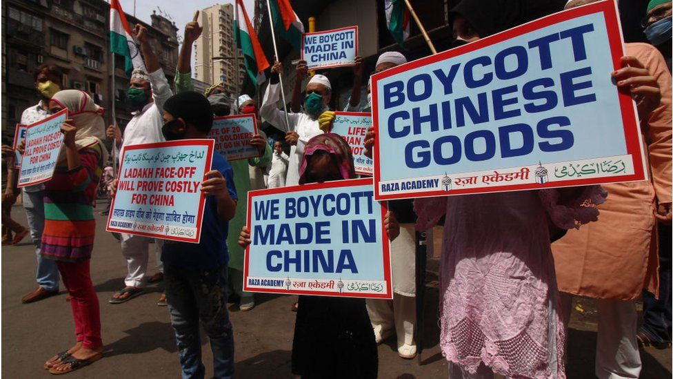 Activists hold placards and shout slogans against China during a protest in Mumbai, India on June 20, 2020.