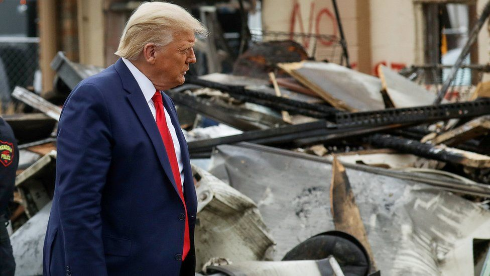 US President Donald Trump views property damage to a business during a visit to Kenosha in the aftermath of protests following the shooting of Jacob Blake by police in Kenosha, Wisconsin.