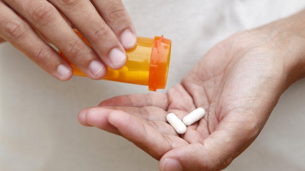 Person holding antibiotics