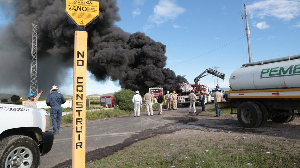 Mexican state-owned oil company Pemex and local firefighters work to control a fire believed to have started in the pipe due to fuel theft activity near the community of Cuesta Blanca, in the state of Puebla, Mexico, 4 July 2017