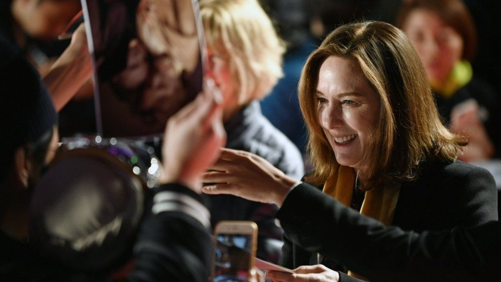 US film producer Kathleen Kennedy signs autographs to fans during the red carpet at Tokyo screening of Star Wars