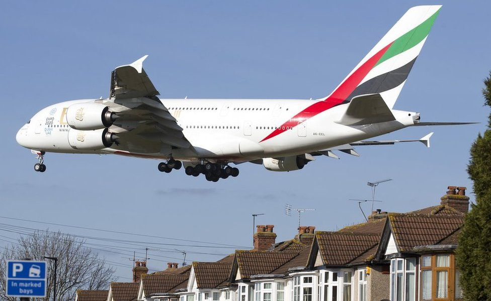 Airbus A380 low over residential housing