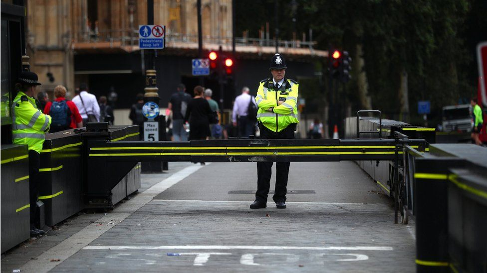 A policeman stands at the scene of the crash on Tuesday