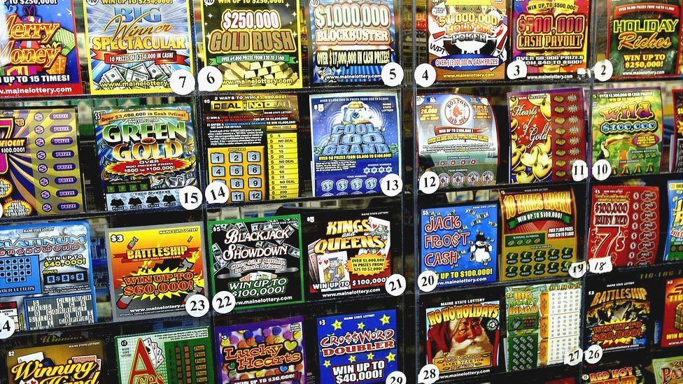 A number of American scratch cards on display in a store