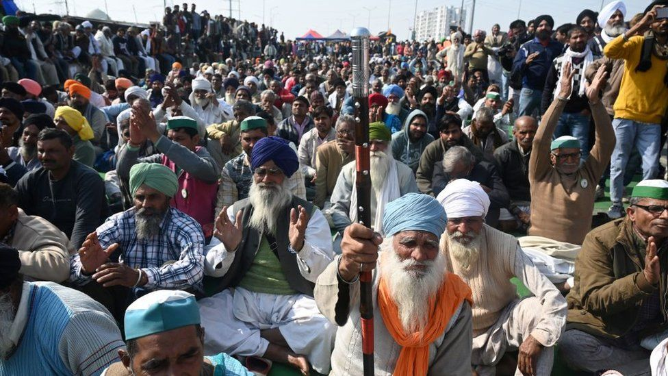 Farmers block a highway during a protest against agricultural reforms at the Delhi-Uttar Pradesh state border in Ghazipur on January 30, 2021