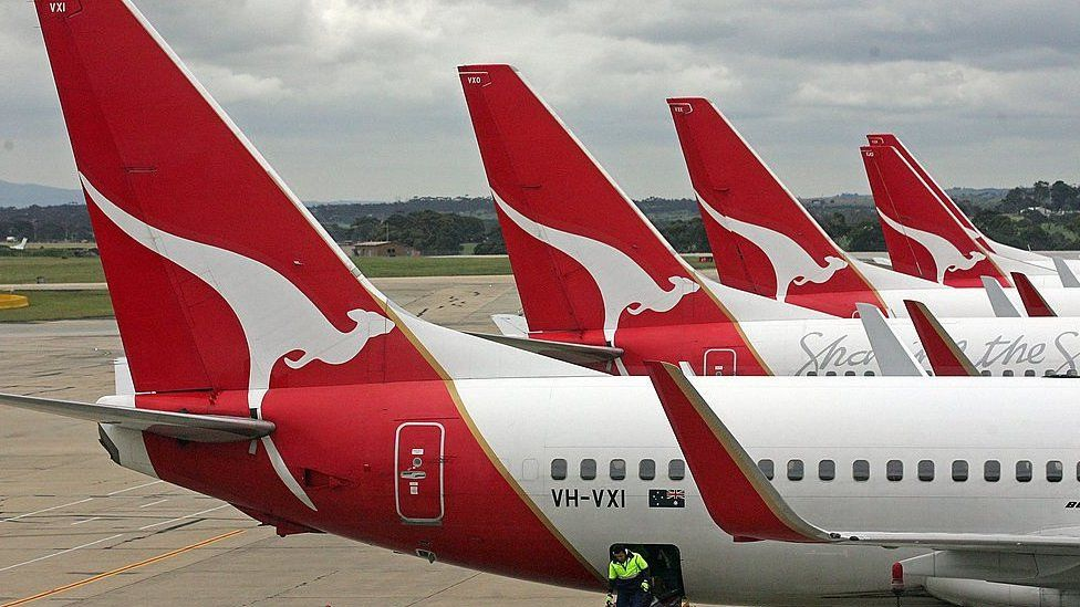 A mixture of Qantas aircraft parked on one of the three runways in Sydney, Australia.