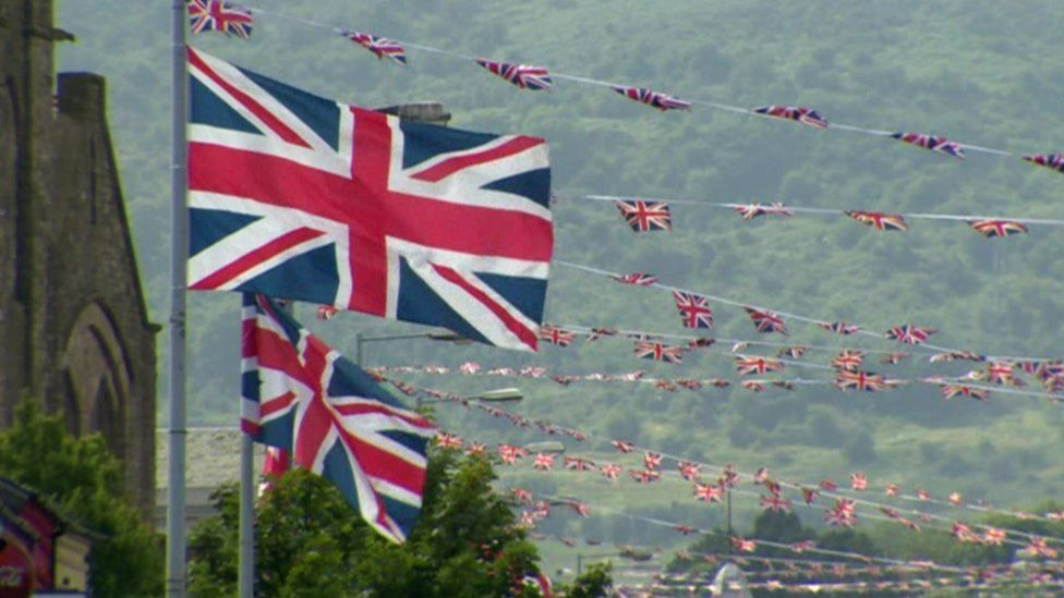 Union flags flying from lampposts in Belfast