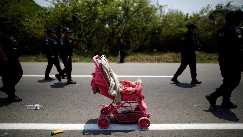 A stroller abandoned by Central American migrants is seen after an immigration raid in their journey towards the United States