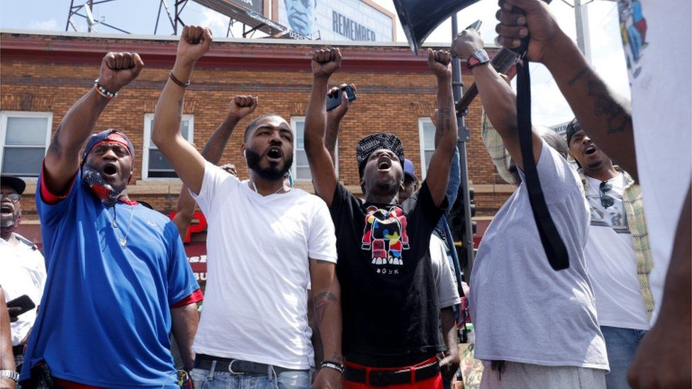 Demonstrators in Minneapolis chant on the anniversary of George Floyd's murder