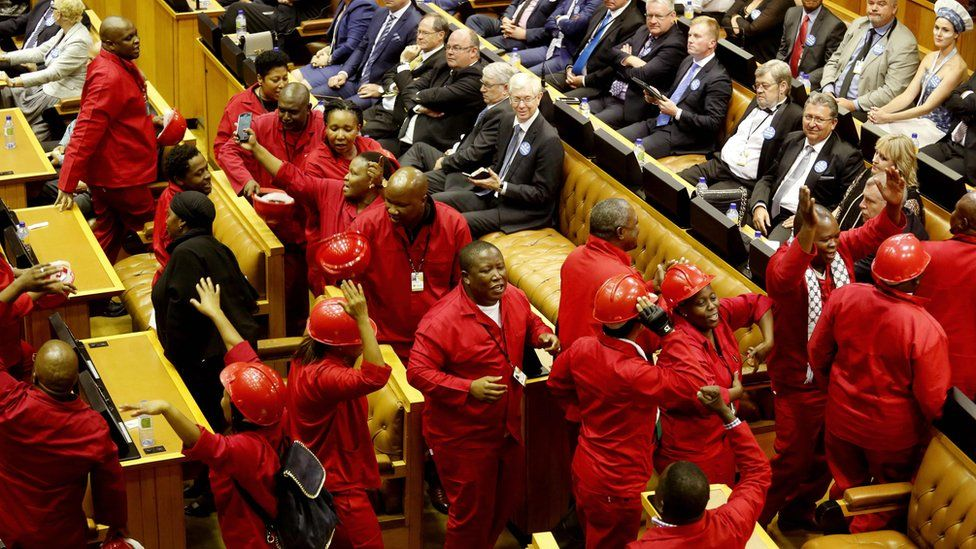 Julius Malema and the Economic Freedom Fighters political party leave parliament in Cape Town, South Africa on February 11, 2016