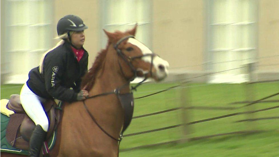Jody Lewis riding a horse