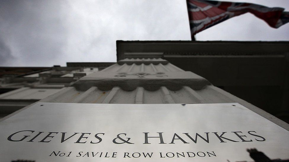 Union Jack flies above Gieves and Hawkes at No 1 Saville Row, London