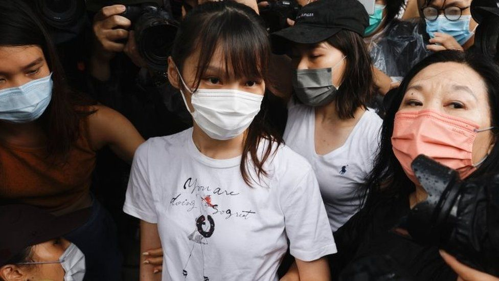 Agnes Chow (centre) leaves prison in Hong Kong. Photo: 12 June 2021