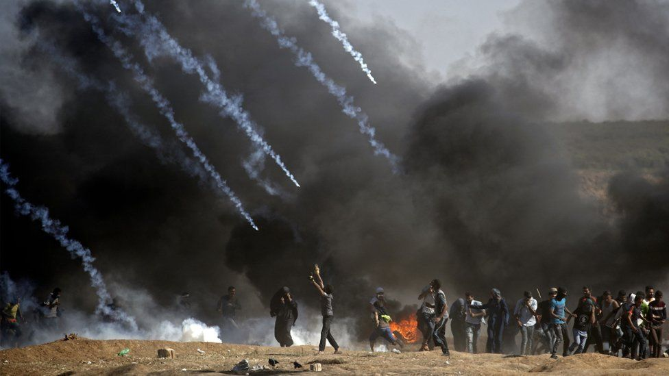Tear gas is fired at protestors during clashes with Israeli forces near the border between the Gaza strip and Israel