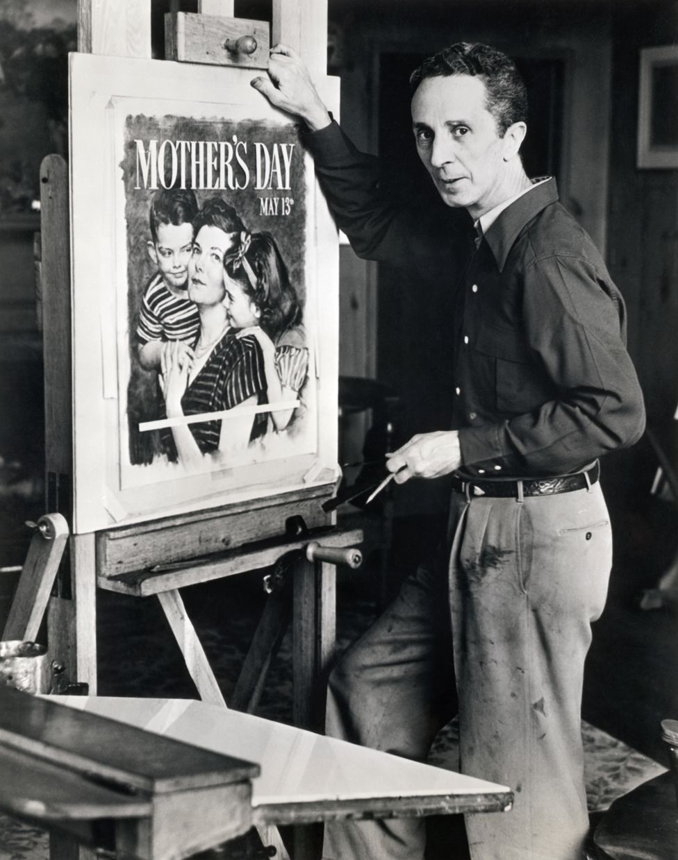 Norman Rockwell (1894-1978) American painter and illustrator, at work on official 1951 Mother's Day poster