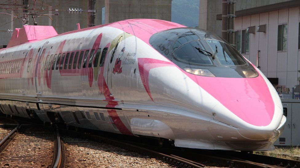 A Shinkansen train adorned with special livery bearing popular character Hello Kitty