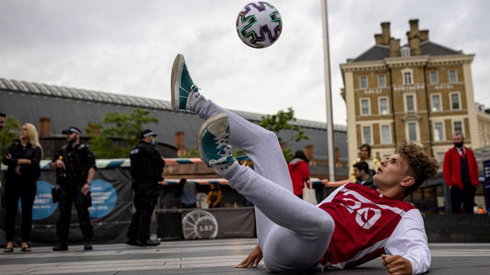A freestyler performs at the ceremony welcoming the Euro 2020 trophy to London