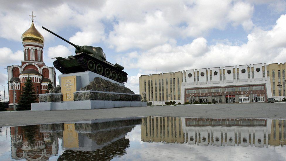A view of the Uralvagonzavod factory with a tank in the foreground