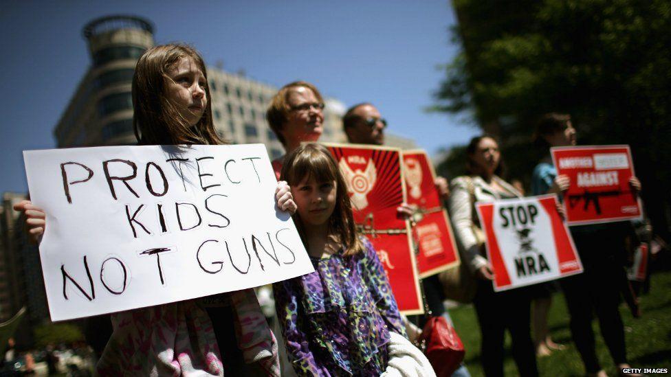 Gun control campaigners protest in McPhearson Square in Washington DC - 25 April 2013