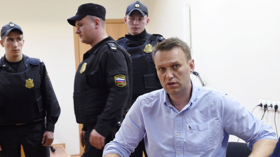 Russian opposition leader Alexei Navalny speaks after a hearing in a court in Moscow, late on June 12, 2017