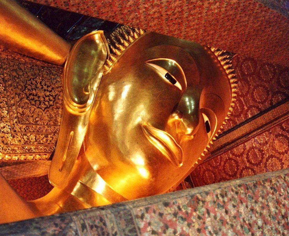 A Buddha in a pavilion