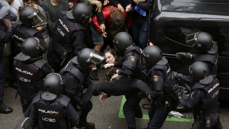 police arresting woman during Catalan referendum