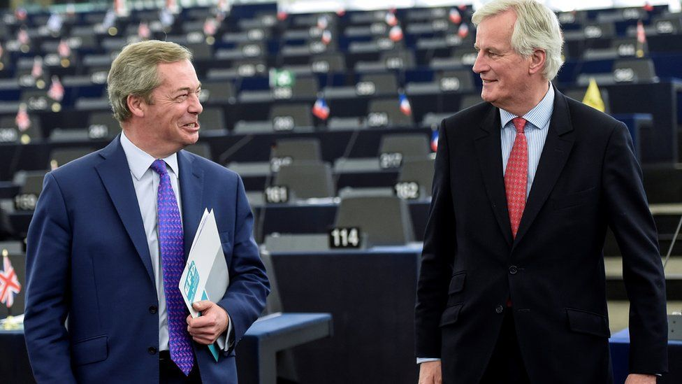 European commission member in charge of Brexit negotiations with Britain, French Michel Barnier (R) speaks with Member of the European Parliament and former leader of the anti-EU UK Independence Party (UKIP) Nigel Farage at the European Parliament in Strasbourg, eastern France, on April 5, 2017