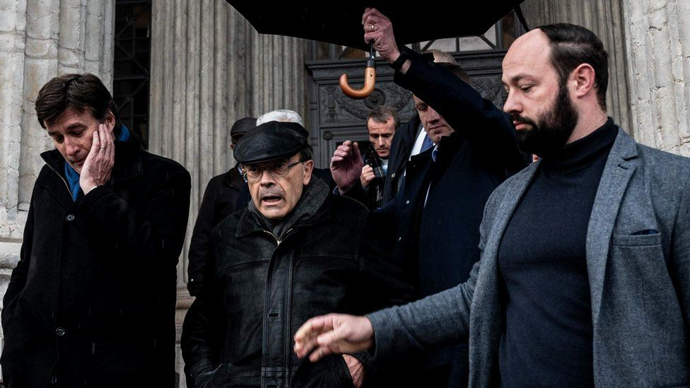 French cardinal Philippe Barbarin (wearing a black cap) leaves Lyon's courthouse after an appeal hearing, 29 November 2019