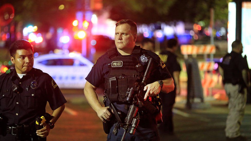 Dallas officers at scene of murder of fellow officers July 7
