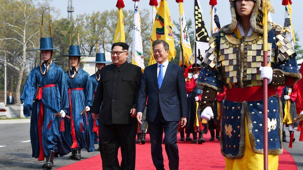 Kim Jong-un and Moon Jae-in walk through the DMZ