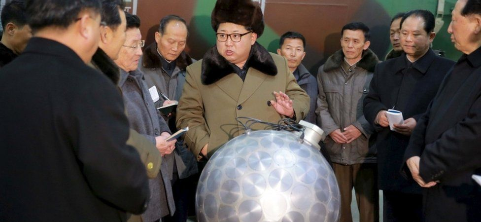 North Korean leader Kim Jong Un inspects what is claimed to be a miniaturized nuclear weapon ( KCNA handout)