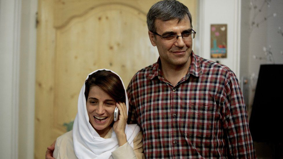 Nasrin Sotoudeh (L) speaks on the phone next to her husband Reza Khandan in 2013