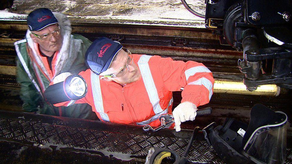 ex-offender inspects Virgin train