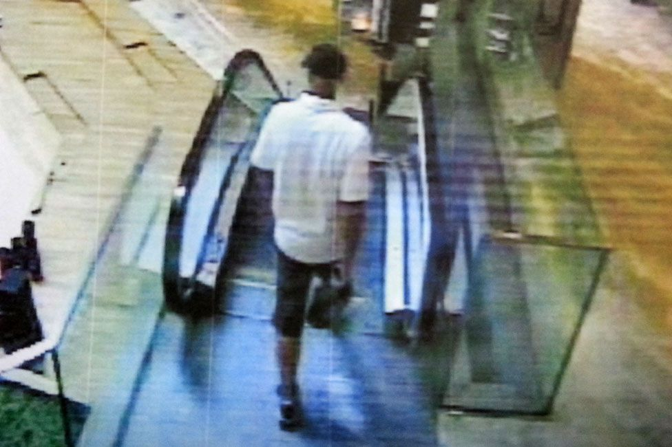 Russian hitman approaching escalator
