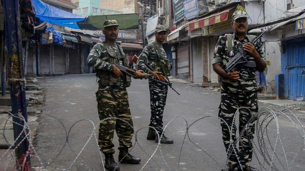 Security personnel stand guard at a roadblock ahead of Muslim's Friday noon prayers in Jammu.