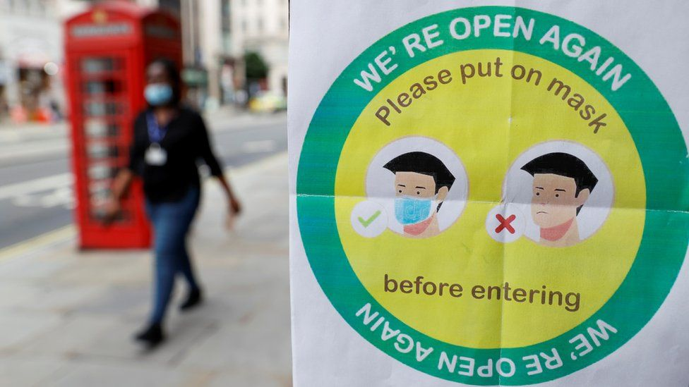 Sign in London urging people to wear face masks