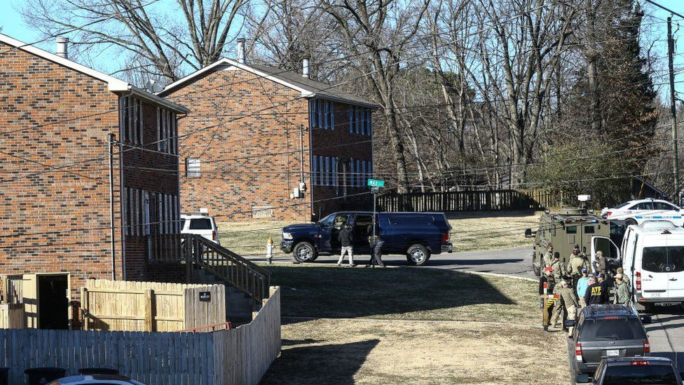 Law enforcement officers investigate the house belonging to Anthony Quinn Warner