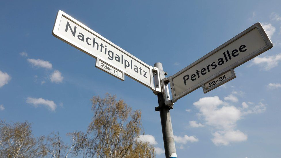 """View taken on April 12, 2018 shows the plates with the street names """"Petersallee"""" and """"Nachtigalplatz"""" in the so-called African Quarter in the northwest of Berlin."""