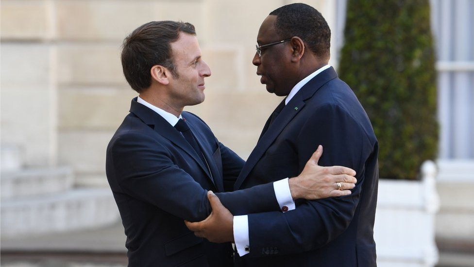 French President Emmanuel Macron (L) welcomes his Senegalese counterpart Macky Sall (R) before a meeting at the Elysee Palace in Paris on May 15, 2018