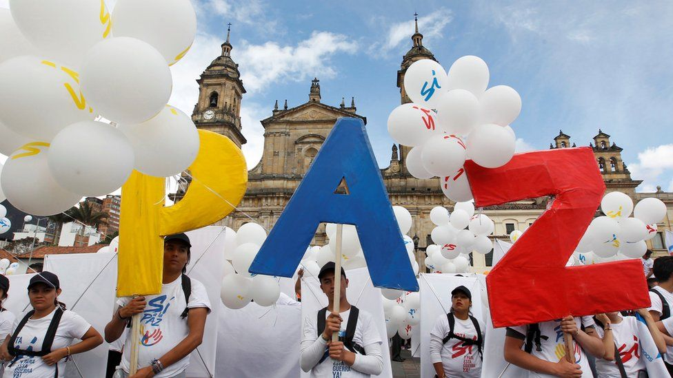 People form the word Peace with letters at the Bolivar square outside the cathedral in Bogota, Colombia, September 26, 2016.