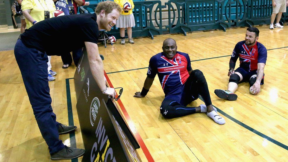 Prince Harry chats to members of the UK sitting volleyball team