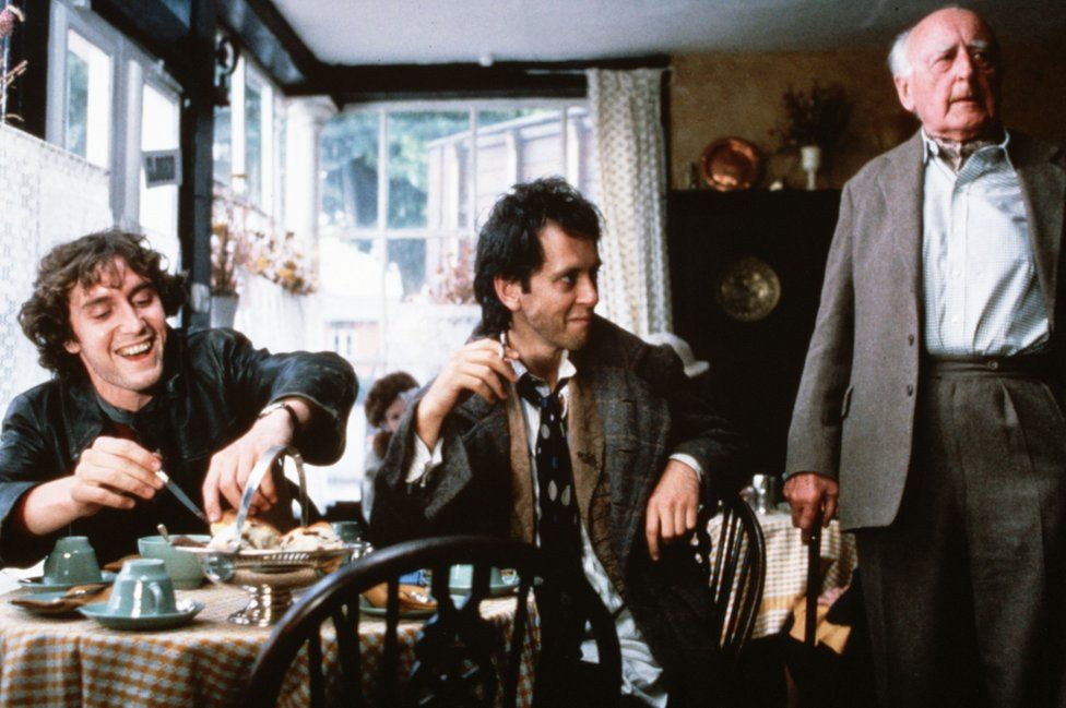 A drunk Withnail (centre) and Marwood (left) annoy the owner of the Penrith Tea Rooms