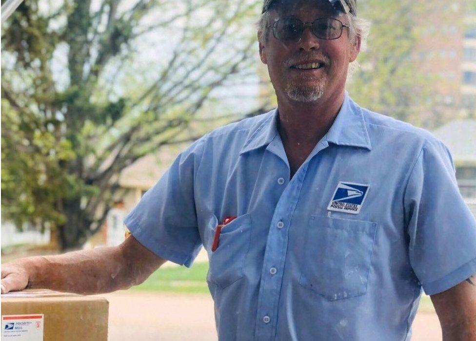 Postman Doug seen outside Emerson Weber's home