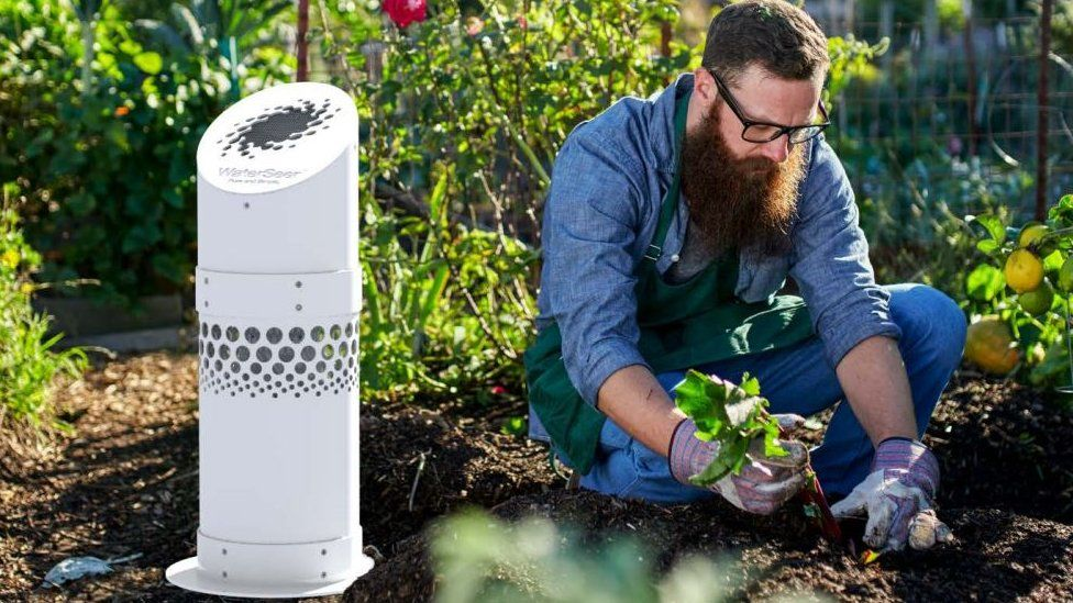 Man gardening next to WaterSeer water condenser