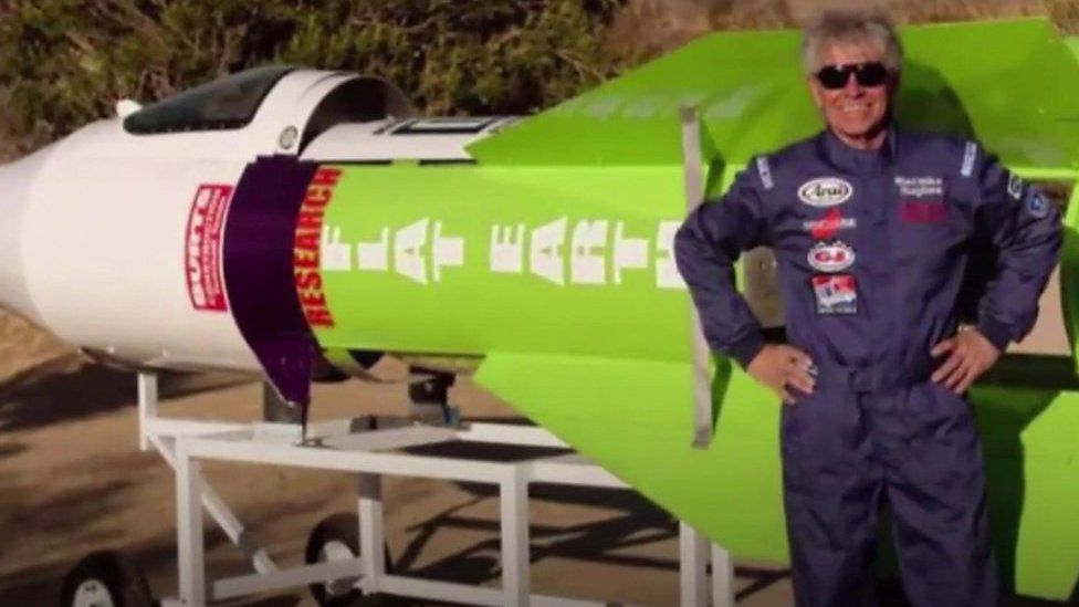 Mike Hughes in front of his rocket