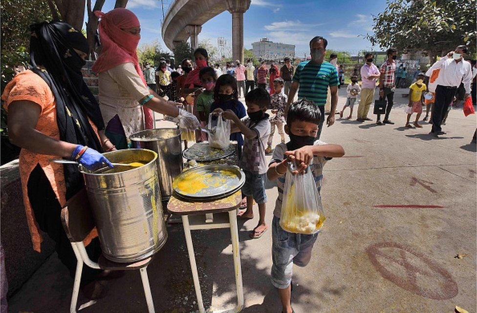 Street children being given food by a charity in Delhi during the coronavirus lockdown