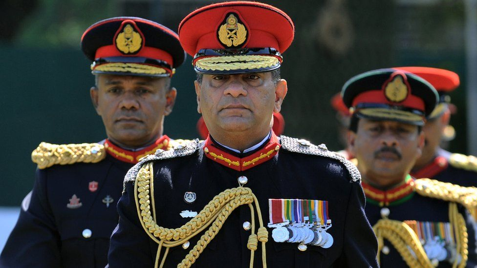 Sri Lanka's outgoing army chief Jagath Jayasuriya (C) and his successor, Major General Daya Ratnayake (L) arrive at a farewell ceremony in the capital Colombo on July 30, 2013.