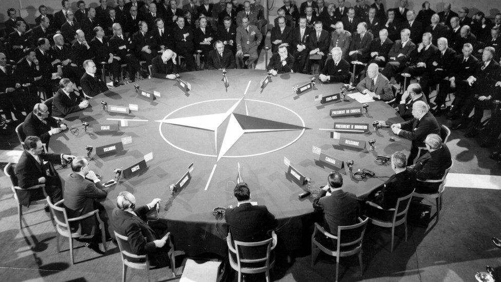 World leaders sitting around a round table